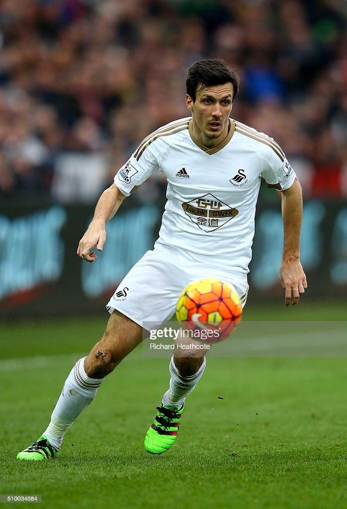 <a gi-track='captionPersonalityLinkClicked' href=/galleries/search?phrase=Jack+Cork&family=editorial&specificpeople=4206991 ng-click='$event.stopPropagation()'>Jack Cork</a> of Swansea in action during the Barclays Premier League match between Swansea City and Southampton at the Liberty Stadium on February 13, 2016 in Swansea, Wales.