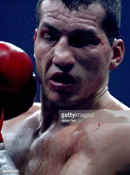 Jack Culcay is punched by Maciej Sulecki during their Super Welter Weights fight at Prudential Center on October 21 2017 in Newark New Jersey