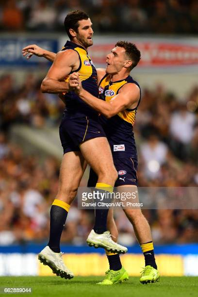 Jack Darling and Luke Shuey of the Eagles celebrates a goal during the 2017 AFL round 01 match between the West Coast Eagles and the St Kilda Saints...