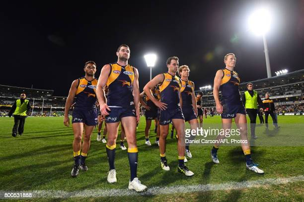 Jack Darling Dom Sheed and Drew Petrie of the Eagles leave the arena after the loss during the 2017 AFL round 14 match between the West Coast Eagles...