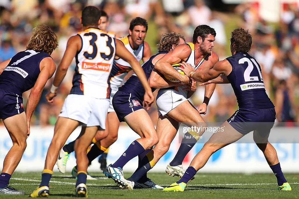 Jack Darling of the Eagles attempts to break from a tackle by David Mundy of the Dockers during the round two NAB Challenge Cup AFL match between the Fremantle Dockers and the West Coast Eagles at Arena Joondalup on February 18, 2014 in Perth, Australia.