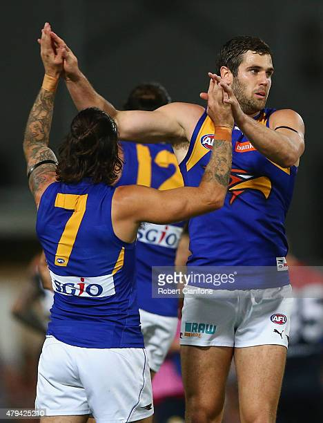 Jack Darling of the Eagles celebrates with Chris Masten after scoring a goal during the round 14 AFL match between the Melbourne Demons and the West...