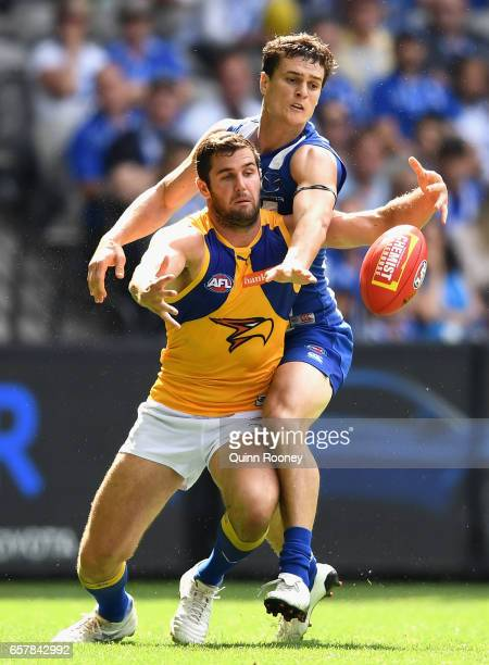 Jack Darling of the Eagles competes for a mark against Scott Thompson of the Kangaroos during the round one AFL match between the North Melbourne...