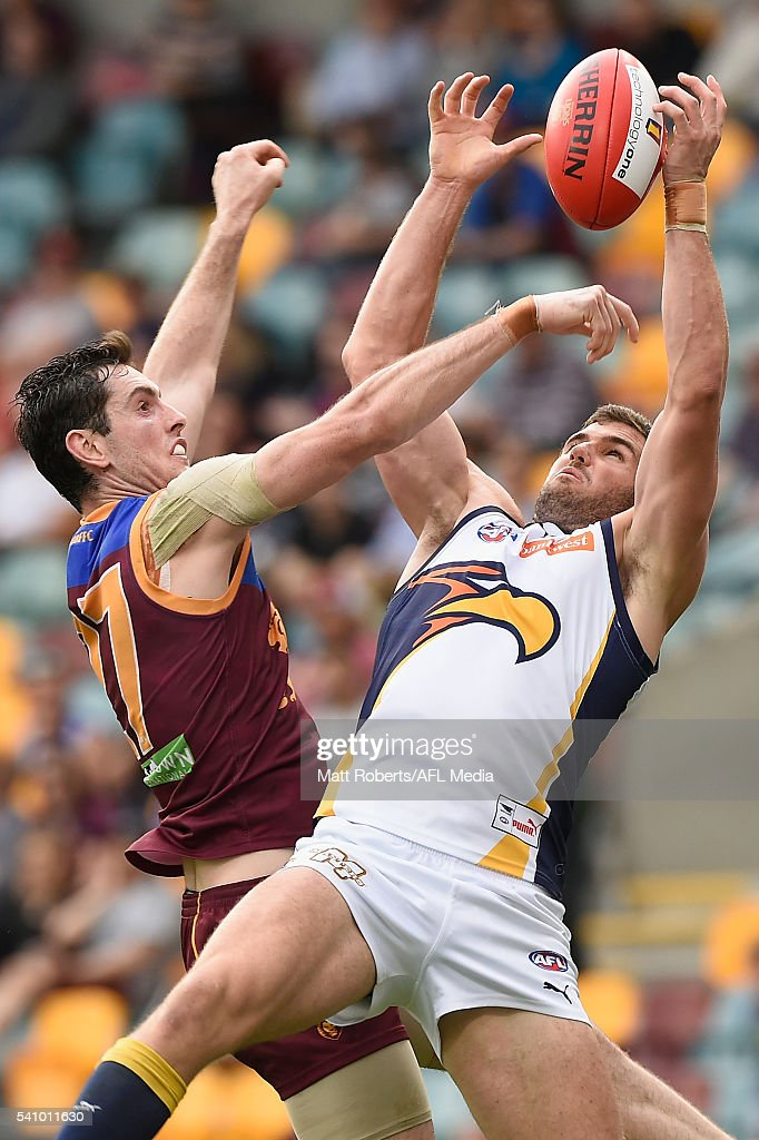 Jack Darling of the Eagles competes for the ball against Darcy Gardiner of the Lions during the round 13 AFL match between the Brisbane Lions and the West Coast Eagles at The Gabba on June 18, 2016 in Brisbane, Australia.