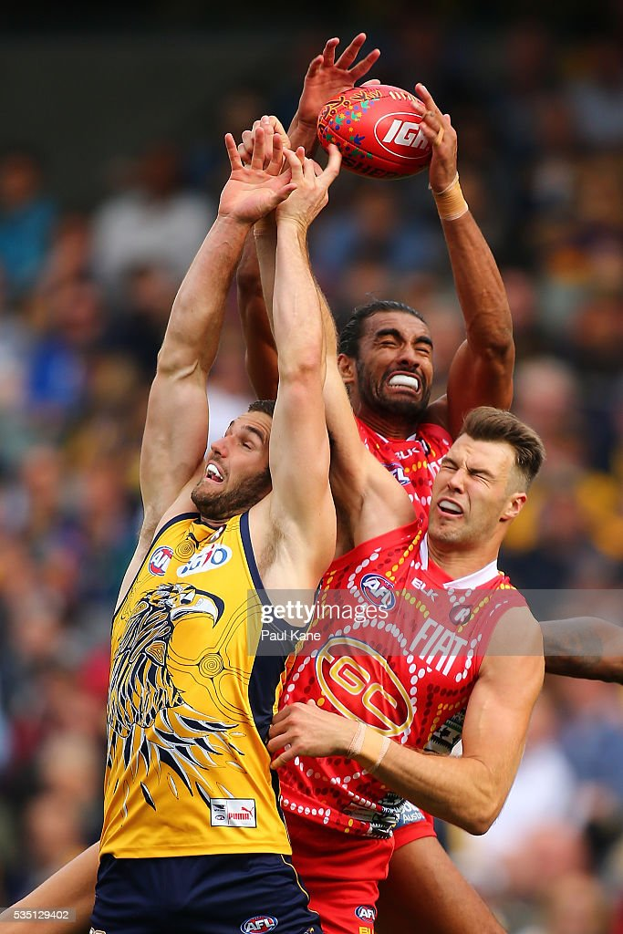 Jack Darling of the Eagles contests a mark against Tom Nicholls and Keegan Brooksby of the Suns during the round 10 AFL match between the West Coast Eagles and the Gold Coast Suns at Domain Stadium on May 29, 2016 in Perth, Australia.