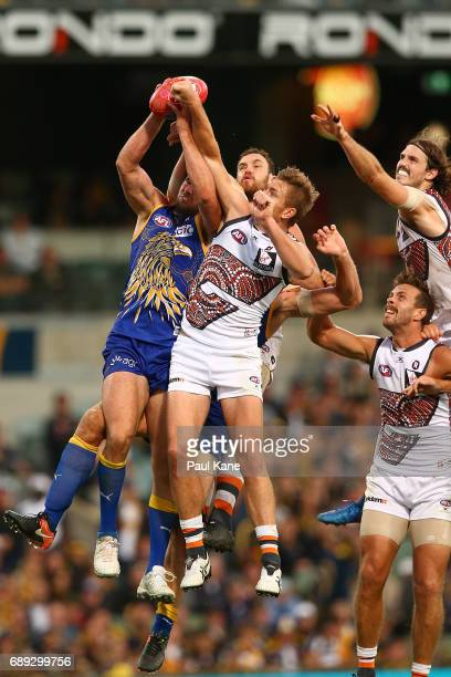 Jack Darling of the Eagles contests for a pack mark during the round 10 AFL match between the West Coast Eagles and the Greater Western Giants at...