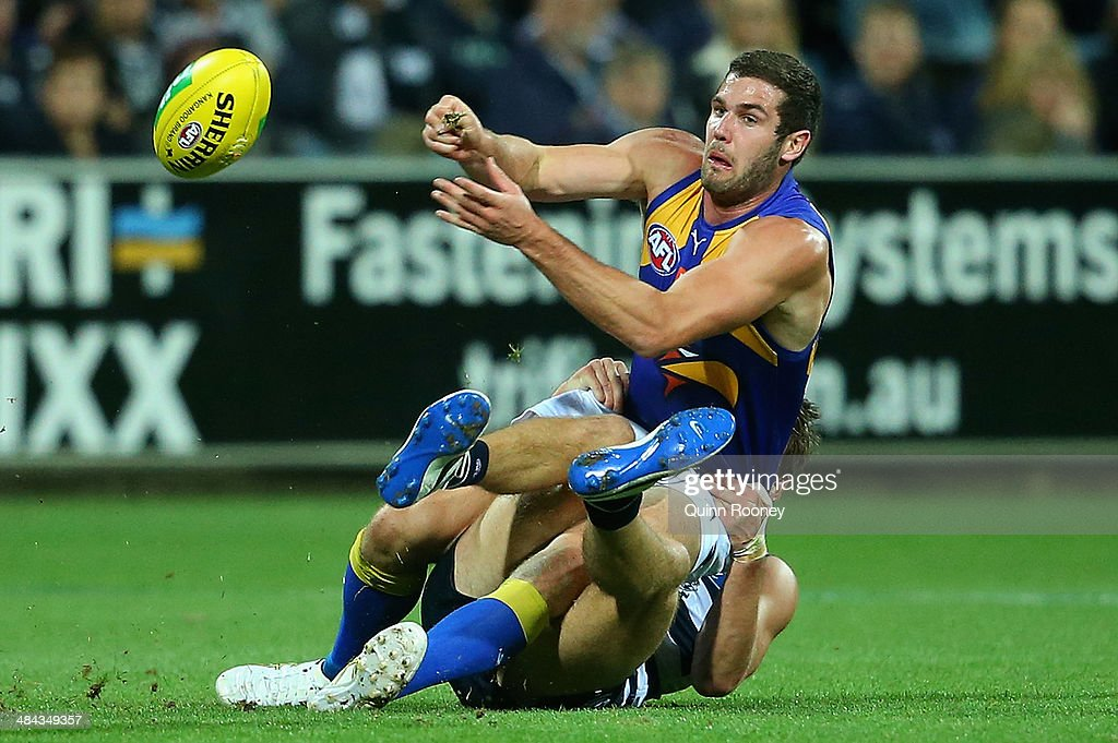 Jack Darling of the Eagles handballs whilst being tackled by <a gi-track='captionPersonalityLinkClicked' href=/galleries/search?phrase=Jared+Rivers&family=editorial&specificpeople=221112 ng-click='$event.stopPropagation()'>Jared Rivers</a> of the Cats during the round four AFL match between the Geelong Cats and the West Coast Eagles at Skilled Stadium on April 12, 2014 in Melbourne, Australia.