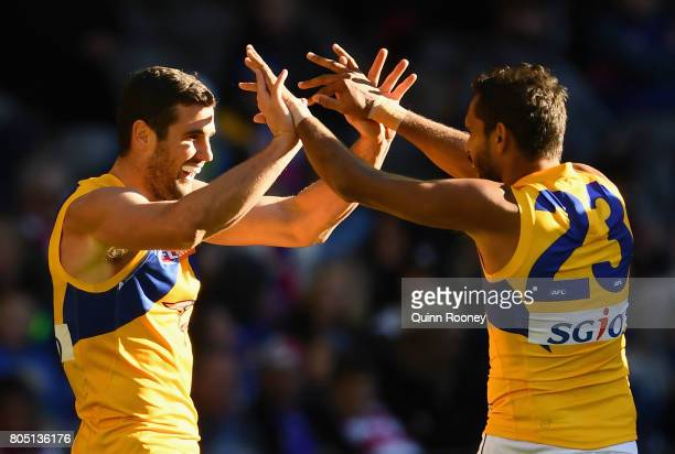 Jack Darling of the Eagles is congratulated by Lewis Jetta after kicking a goal during the round 15 AFL match between the Western Bulldogs and the...