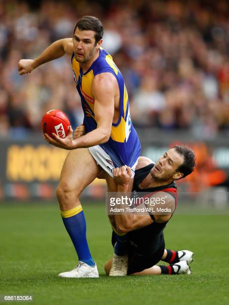 Jack Darling of the Eagles is tackled by Matt Dea of the Bombers during the 2017 AFL round 09 match between the Essendon Bombers and the West Coast...