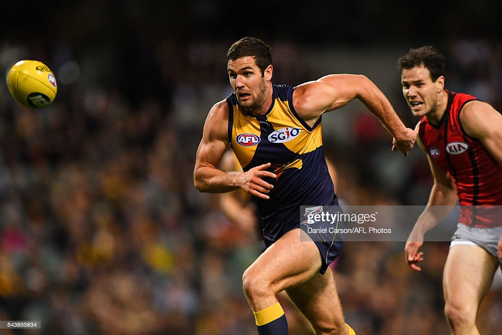Jack Darling of the Eagles leads the chase for the ball during the 2016 AFL Round 14 match between the West Coast Eagles and the Essendon Bombers at Domain Stadium on June 30, 2016 in Perth, Australia.