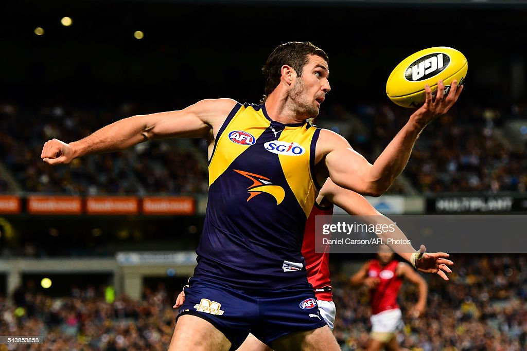 Jack Darling of the Eagles looks to handball over his head during the 2016 AFL Round 14 match between the West Coast Eagles and the Essendon Bombers at Domain Stadium on June 30, 2016 in Perth, Australia.