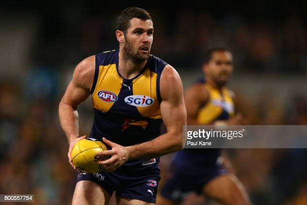 Jack Darling of the Eagles looks to pass the ball during the round 14 AFL match between the West Coast Eagles and the Melbourne Demons at Domain...