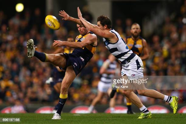 Jack Darling of the Eagles snaps on goal against Daniel Menzel of the Cats during the round 13 AFL match between the West Coast Eagles and the...