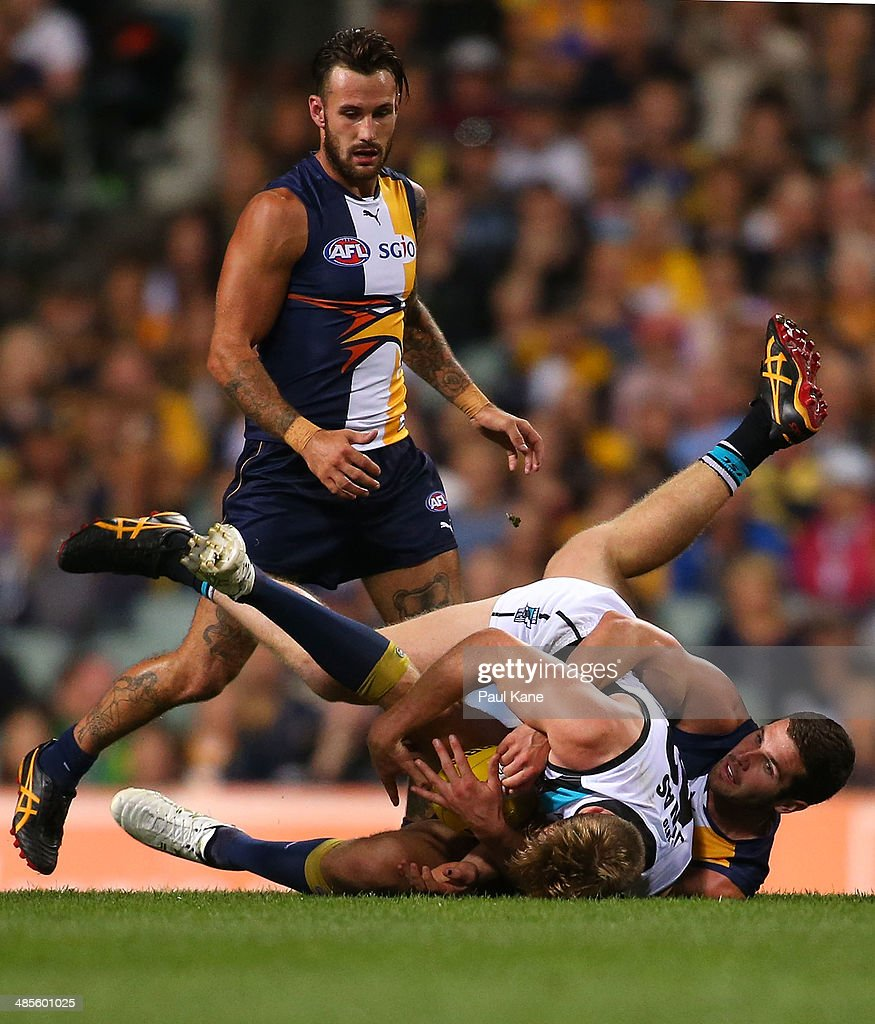 Jack Darling of the Eagles tackles Tom Jonas of the Power during the round five AFL match between the West Coast Eagles and the Port Power at Patersons Stadium on April 19, 2014 in Perth, Australia.