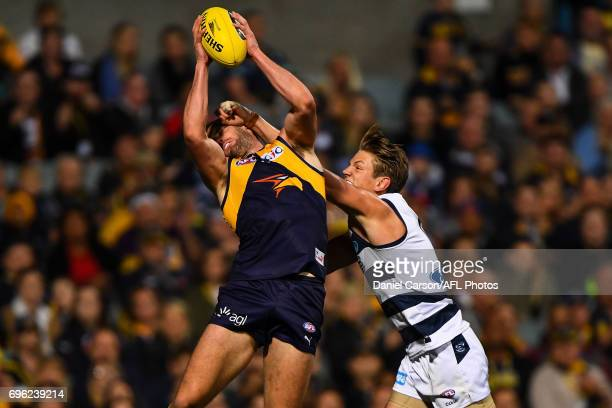 Jack Darling of the Eagles takes a mark over Rhys Stanley of the Cats during the 2017 AFL round 13 match between the West Coast Eagles and the...
