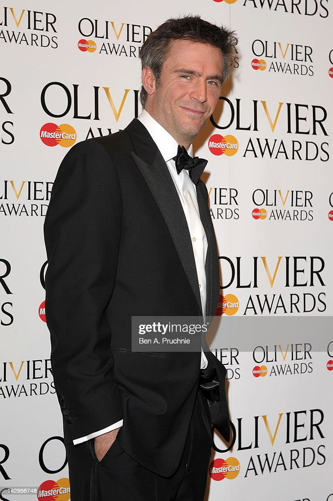 Jack Davenport poses in the press room during the 2012 Olivier Awards at The Royal Opera House on April 15 2012 in London England