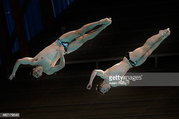 Jack David Laugher and Chris Mears of Great Britain compete in the Men's 3m Springboard Synchronised Diving Preliminary on day four of the 16th FINA...