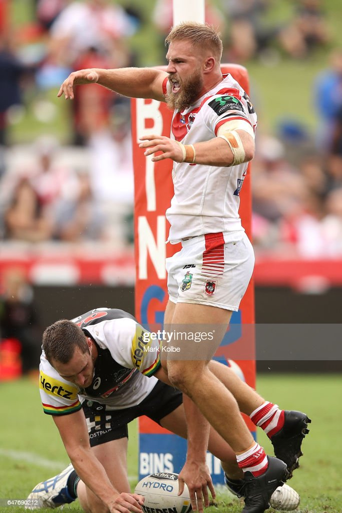 Jack de Belin of the Dragons celebrates scoring a try as Isaah Yeo of the Panthers looks dejected during the round one NRL match between the St George Illawarra Dragons and the Penrith Panthers at UOW Jubilee Oval on March 4, 2017 in Sydney, Australia.