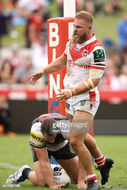 Jack de Belin of the Dragons celebrates scoring a try during the round one NRL match between the St George Illawarra Dragons and the Penrith Panthers...