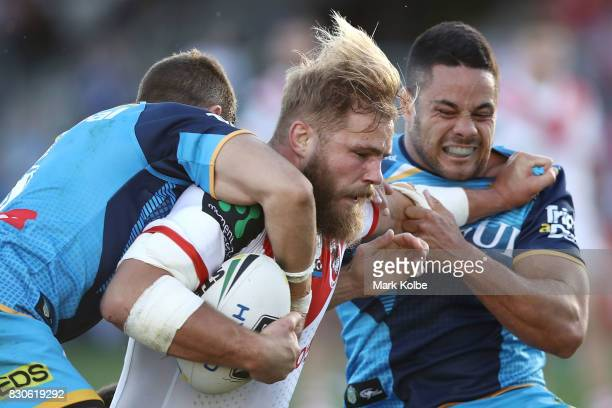 Jack de Belin of the Dragons is tackled by Jarryd Hayne of the Titans during the round 23 NRL match between the St George Illawarra Dragons and the...