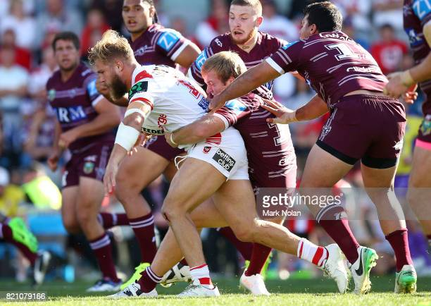 Jack De Belin of the Dragons is tackled during the round 20 NRL match between the St George Illawarra Dragons and the Manly Sea Eagles at WIN Stadium...
