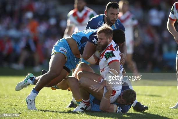 Jack de Belin of the Dragons is tackled during the round 23 NRL match between the St George Illawarra Dragons and the Gold Coast Titans at UOW...