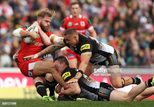 Jack de Belin of the Dragons is tackled during the round 25 NRL match between the Penrith Panthers and the St George Illawarra Dragons at Pepper...