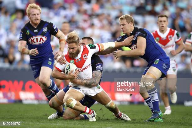 Jack de Belin of the Dragons is tackled during the round 26 NRL match between the St George Illawarra Dragons and the Canterbury Bulldogs at ANZ...