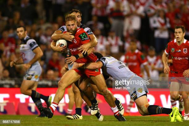 Jack de Belin of the Dragons is tackled during the round seven NRL match between the St George Illawarra Dragons and the North Queensland Cowboys at...