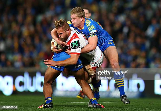 Jack De Belin of the Dragons is takcled during the round 25 NRL match between the Parramatta Eels and the St George Illawarra Dragons at Pirtek...
