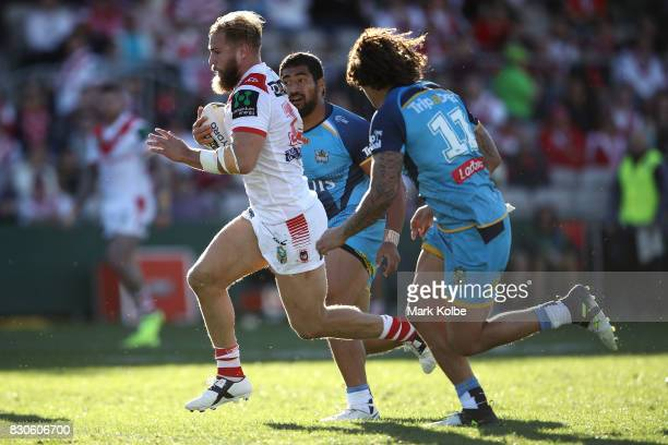 Jack de Belin of the Dragons makes a break during the round 23 NRL match between the St George Illawarra Dragons and the Gold Coast Titans at UOW...