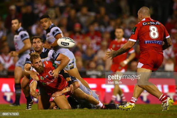 Jack de Belin of the Dragons offloads the ball to Russell Packer of the Dragons during the round seven NRL match between the St George Illawarra...