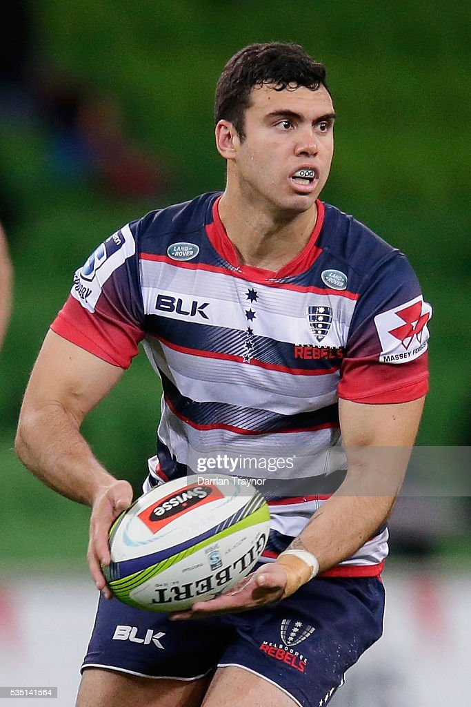 Jack Debreczani of the Rebels passes the ball during the round 14 Super Rugby match between the Rebels and the Force at AAMI Park on May 29, 2016 in Melbourne, Australia.