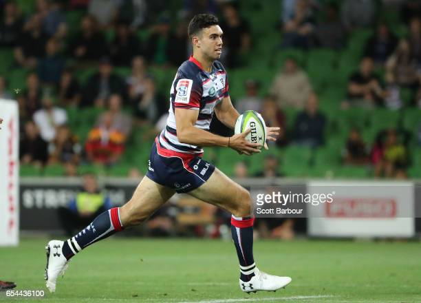Jack Debreczeni of the Rebels runs with the ball during the round four Super Rugby match between the Rebels and the Chiefs at AAMI Park on March 17...