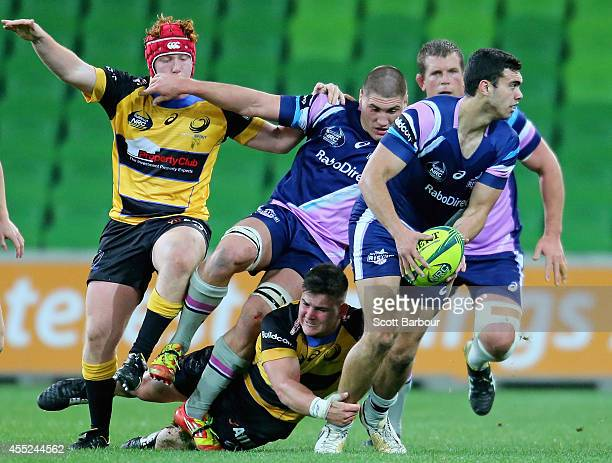 Jack Debreczeni of the Rising makes a break during the round four National Rugby Championship match between Melbourne Rising and Perth Spirit at AAMI...