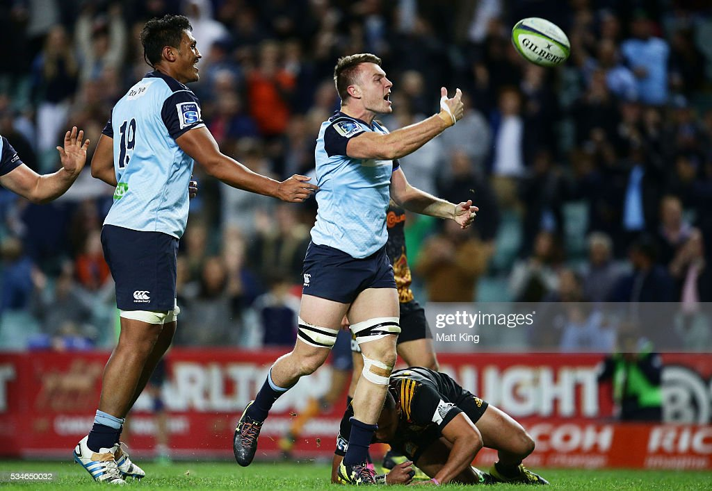Jack Dempsey of the Waratahs celebrates scoring a try during the round 14 Super Rugby match between the Waratahs and the Chiefs at Allianz Stadium on May 27, 2016 in Sydney, Australia.