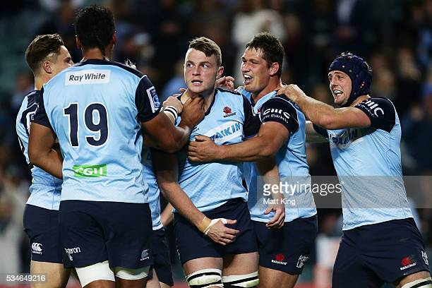 Jack Dempsey of the Waratahs celebrates with team mates after scoring a try during the round 14 Super Rugby match between the Waratahs and the Chiefs...