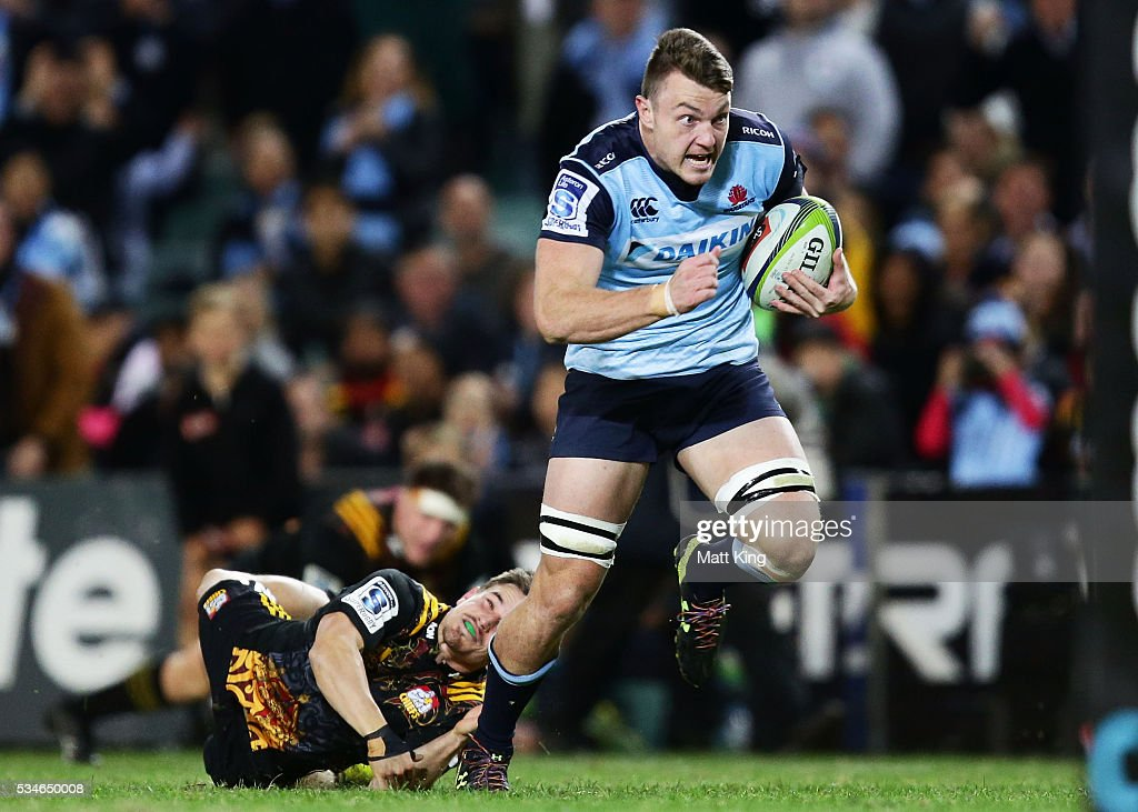 Jack Dempsey of the Waratahs charges towards the line to score a try during the round 14 Super Rugby match between the Waratahs and the Chiefs at Allianz Stadium on May 27, 2016 in Sydney, Australia.