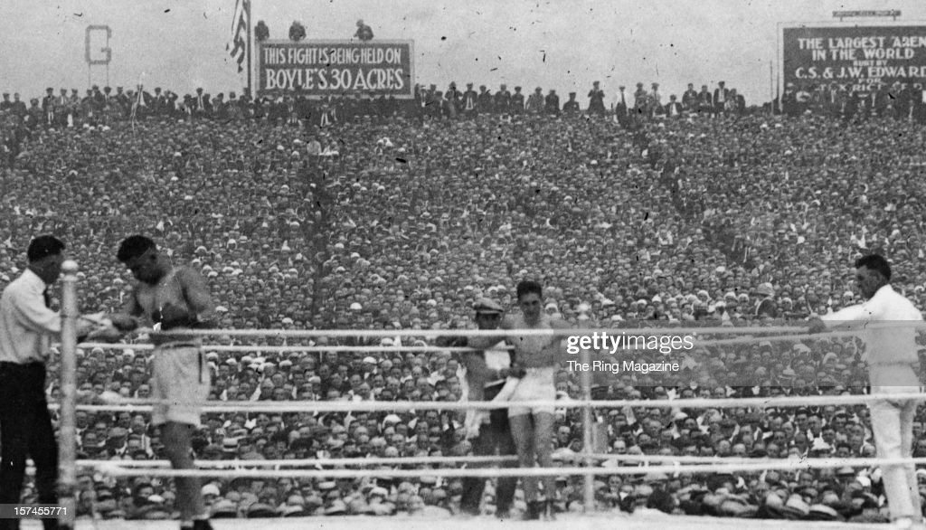 Jack Dempsey rest in his corner as Georges Carpentier stands in his during the fight at Boyle's Thirty Acreson July 21921 in Jersey City New Jersey...