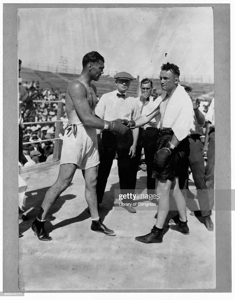 Jack Dempsey shakes hands with Heavyweight Champion Jess Willard before their 1919 bout Dempsey would win the match in three rounds becoming...