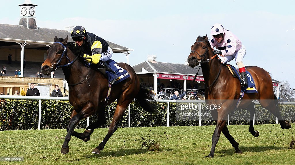 Jack Dexter ridden by Graham Lee wins the William Hill New iPad App Cammidge Trophy (Class1) race ahead of Captain Ramius ridden by Franny Norton at Doncaster Racecourse on March 30, 2013 in Doncaster, England.