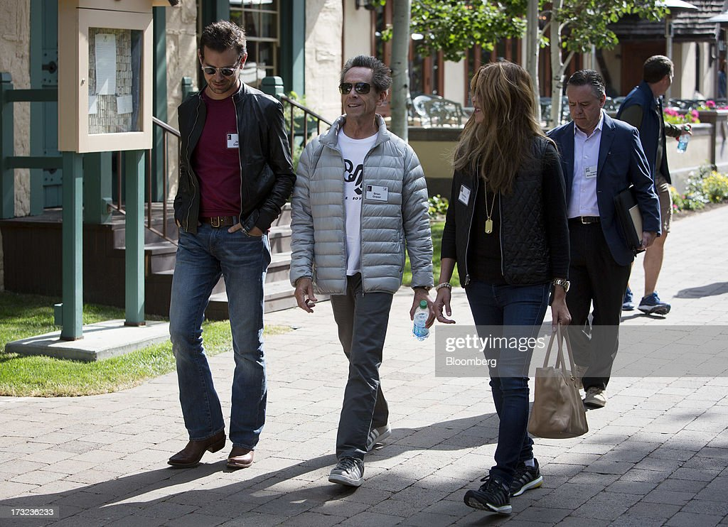 Jack Dorsey, chairman and co-founder of Twitter Inc., left, and Brian Grazer, co-chairman of Imagine Entertainment, center, walk the grounds at the Allen & Co. Media and Technology Conference in Sun Valley, Idaho, U.S., on Wednesday, July 10, 2013. Executives from media, finance and politics mingle at the mountain resort between presentations on business trends and social issues, brought together by New York investment banker Herb Allen. Photographer: Scott Eells/Bloomberg via Getty Images