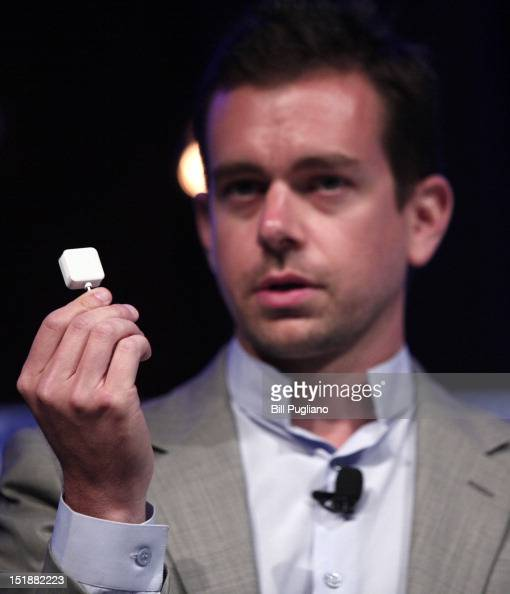 Jack Dorsey Chairman of Twitter and CEO of Square holds up a Square credit card reader as he speaks at TECHONOMYDETROIT September 12 2012 in Detroit...
