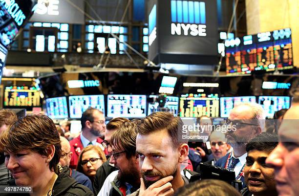 Jack Dorsey chief executive officer of Square Inc center tours the floor of the New York Stock Exchange in New York US on Thursday Nov 19 2015 Square...