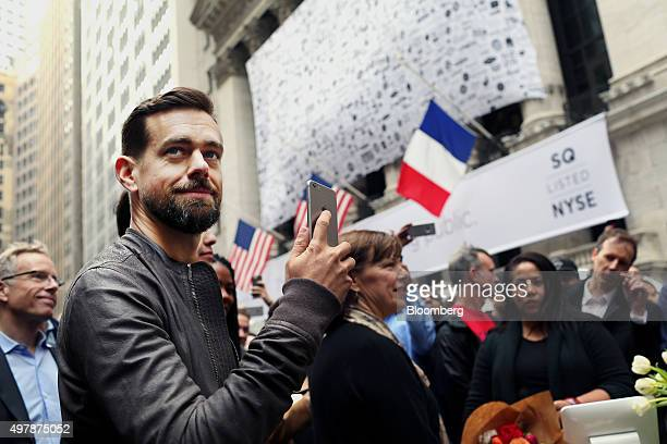 Jack Dorsey chief executive officer of Square Inc holds an Apple Inc iPhone while standing outside of the New York Stock Exchange in New York US on...