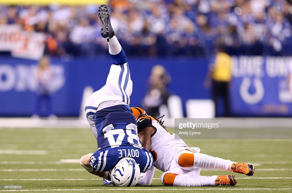 Jack Doyle #84 of the Indianapolis Colts is tackled by Rey Maualaga #58 of the Cincinnati Bengals during their AFC Wild Card game at Lucas Oil Stadium on January 4, 2015 in Indianapolis, Indiana.