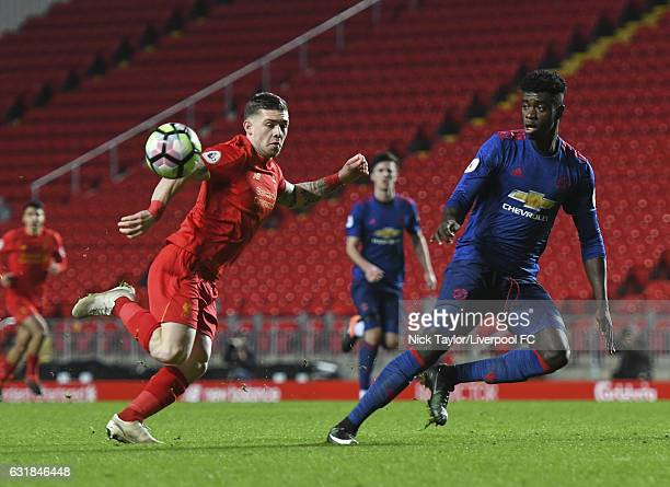 Jack Dunn of Liverpool and Axel Tuanzebe of Manchester United in action during the Liverpool v Manchester United Premier League 2 game at Anfield on...