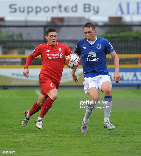 Jack Dunn of Liverpool and Matthew Pennington of Everton in action during the Everton v Liverpool Barclays U21 Premier League game at the Merseyrail...