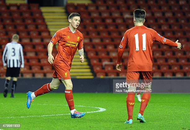 Jack Dunn of Liverpool celebrates scoring his first goal of the game with team mate Ryan Kent during the Barclays Premier League Under 21 fixture...