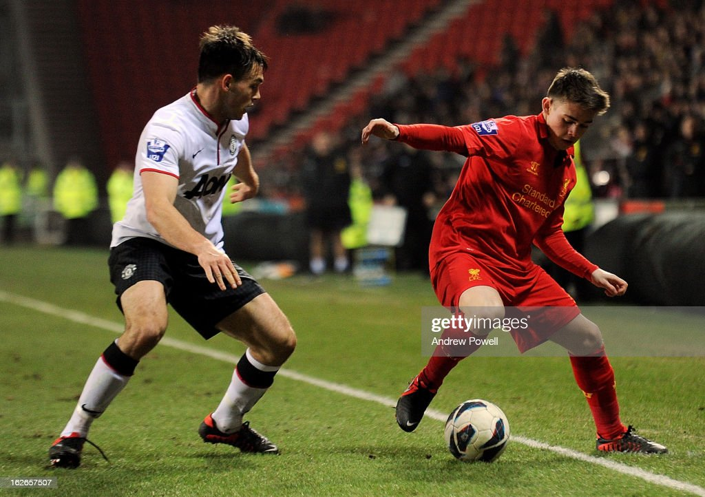 Jack Dunn of Liverpool competes with Frederic Veseli of Manchester United Reserves during the Barclays Premier Reserve League match between Liverpool Reserves and Manchester United at Langtree Park on February 25, 2013 in St Helens, England.